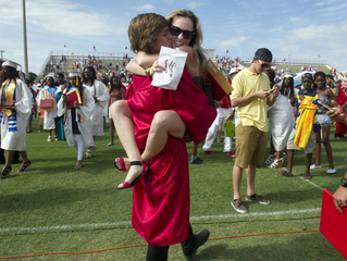 Kristen Linsky congratulates her little brother, Hunter Cureton, after the Vero Beach High School commencement ceremony Saturday at the Citrus Bowl in Vero Beach. This was the largest graduating class to date. (MOLLY BARTELS/TREASURE COAST NEWSPAPERS)