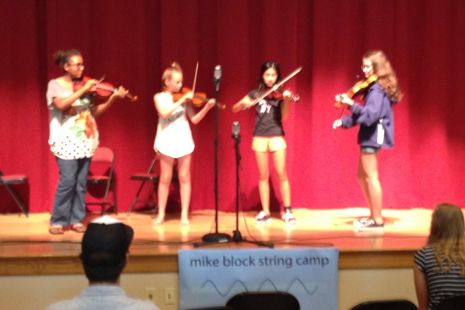 Four girls on stage