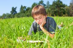 child-reading-book-outdoor-boy-lying-grass-summer-field-45293574