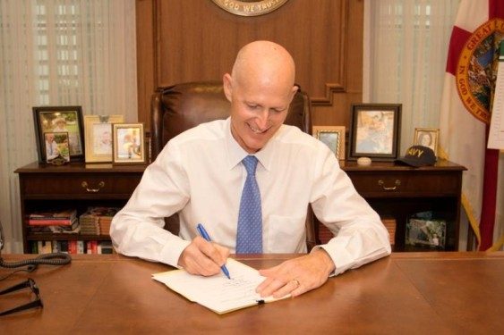 scott-rick-signing-budget-e1456866249955