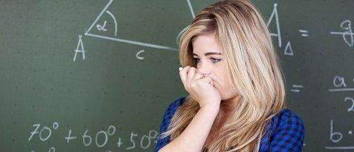 Teenager-doing-math-in-high-school-classroom-750x325